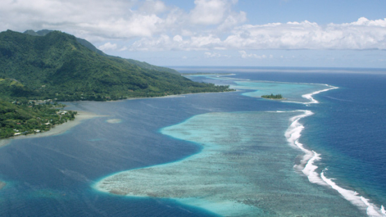 Aerial view of Moorea, east coast and barrier reef, 4K UHD