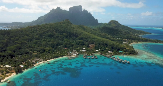 Bora Bora 4k drone, aerial view of resort in front of the island