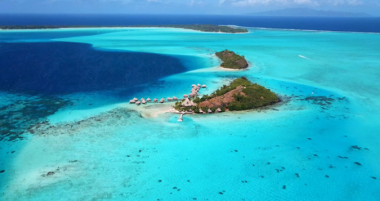Bora Bora 4k drone, aerial descending view of a resort in front of the lagoon