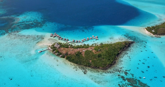 Bora Borak drone , aerial descending view of a resort in front of the lagoon