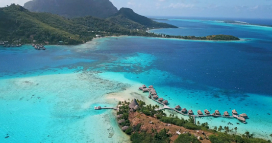 Bora Bora 4k drone , aerial up view of a resort in front of the island
