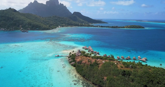 Bora Bora 4k drone, aerial view of a resort in front of the island