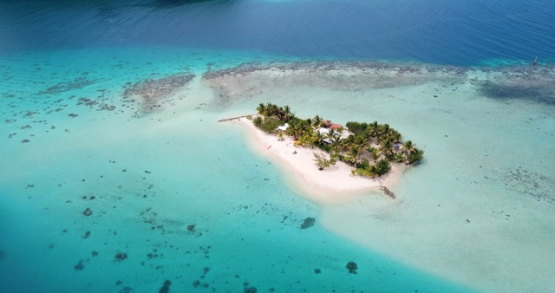 Huahine 4k drone, aerial view of the motu in the lagoon