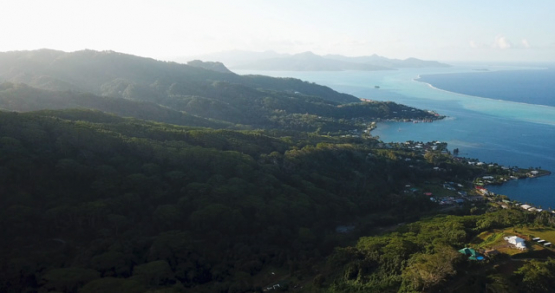 Raiatea 4k drone, aerial view of the mountains with Tahaa in background at sunset