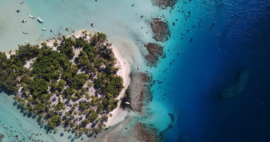 Tahaa 4k drone, aerial view above a motu