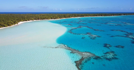 Maupiti 4k drone, aerial view of the bleu gradient of the lagoon