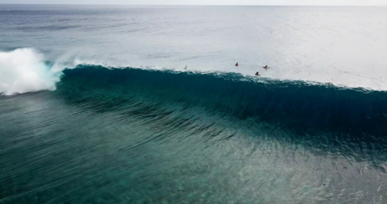 Tahiti 4K drone, aerial view of Teahupoo wave breaking