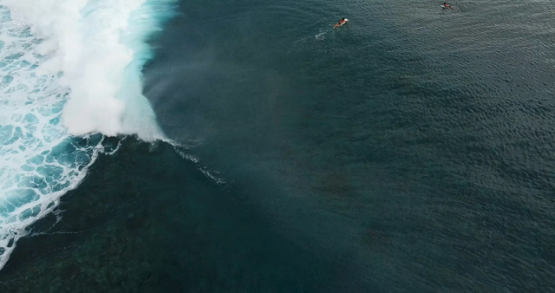Tahiti 4K drone, aerial view of surfer inside a barrel on Teahupoo wave