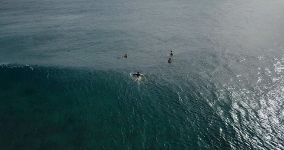 Tahiti 4K drone, aerial view of surfer paddling on Teahupoo wave
