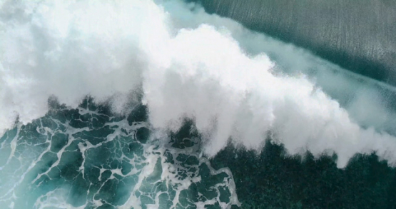 Tahiti 4K drone, aerial view of breaking Teahupoo wave