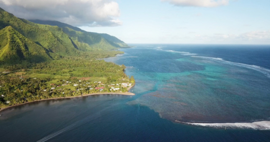 Tahiti, aerial view of Teahupoo lagoon and beach at sunset, leftside
