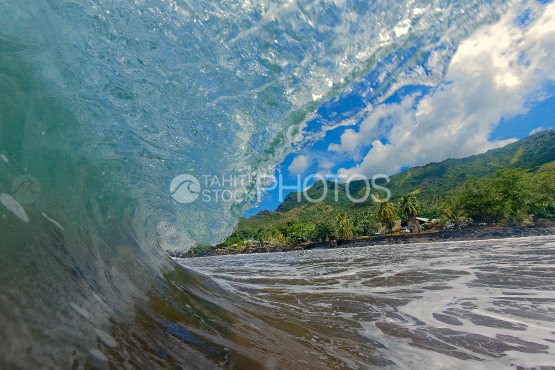 photography taken inside a tube wave at nuku hiva beach