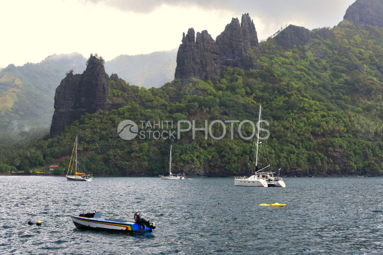Sailboats anchored in the hatiheu bay, north of nuku hiva