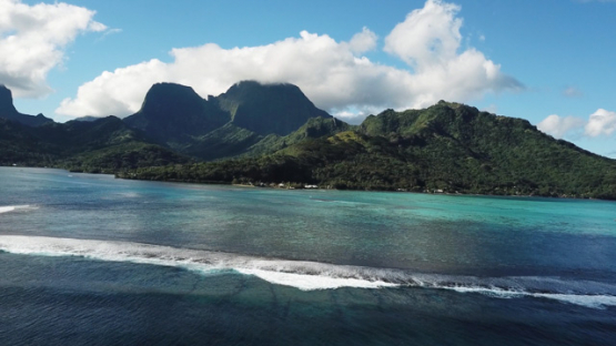 Aerial view by drone of west coast of Moorea along the barrier reef, 4K UHD