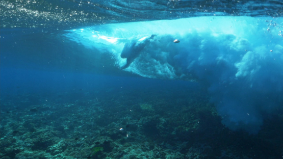 Tahiti, Body surfer in the Wave from underwater
