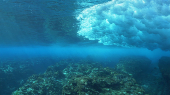 Tahiti, Wave shot from underwater near the coral reef