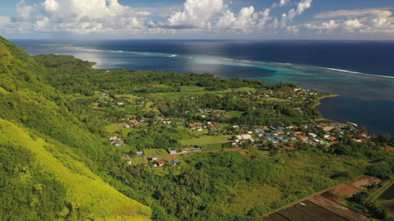Peninsula of Tahiti, aerial view by drone of village Teahupoo and the oceanic coast